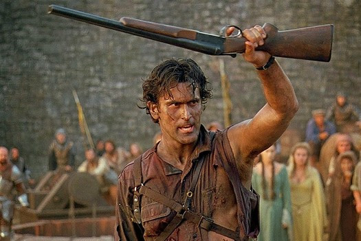 "Ash (Bruce Campbell) with his trusty boomstick in ""Army of Darkness"""