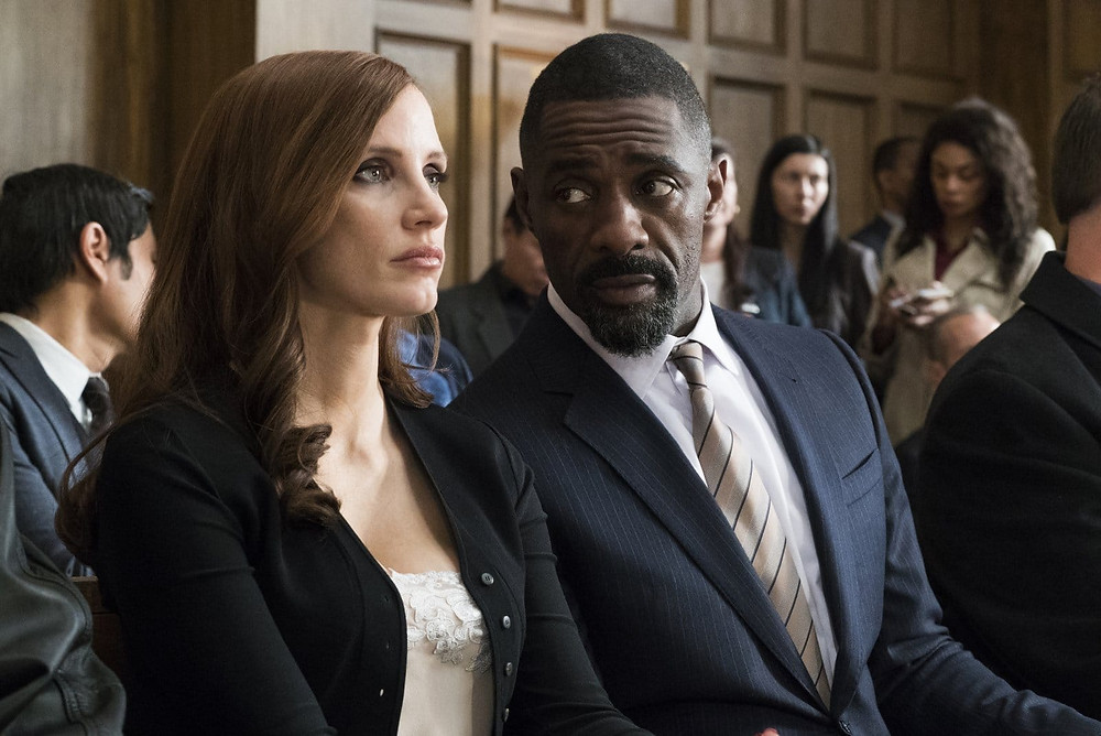 "Jessica Chastain and Idris Elba in ""Molly's Game"""