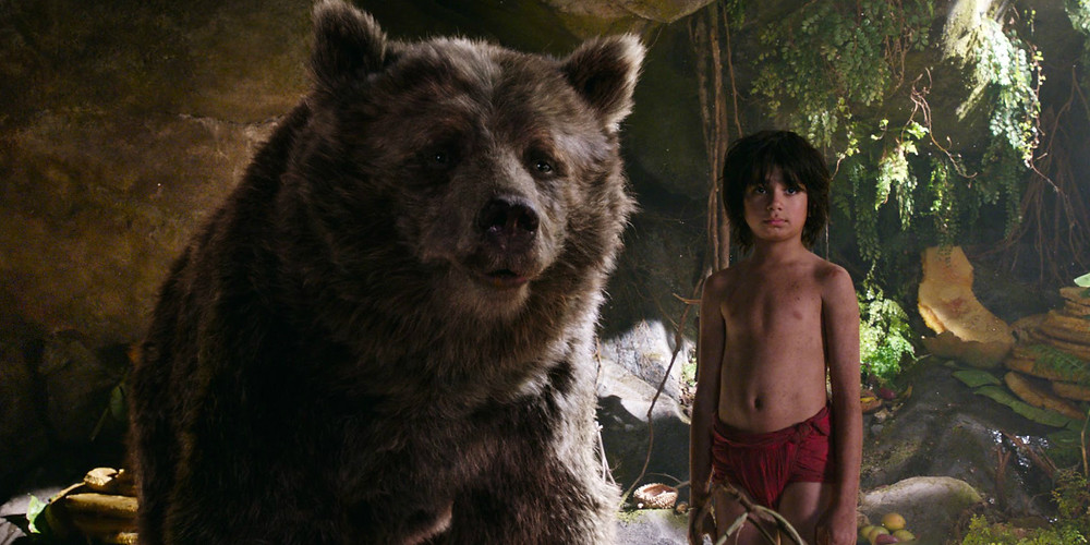 "Baloo (Voice of Bill Murray) and Mogli (Neel Sethi) in ""The Jungle Book"""