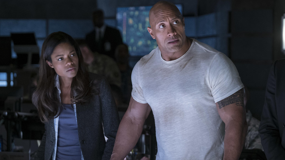 "Naomie Harris and Dwayne Johnson in ""Rampage"""
