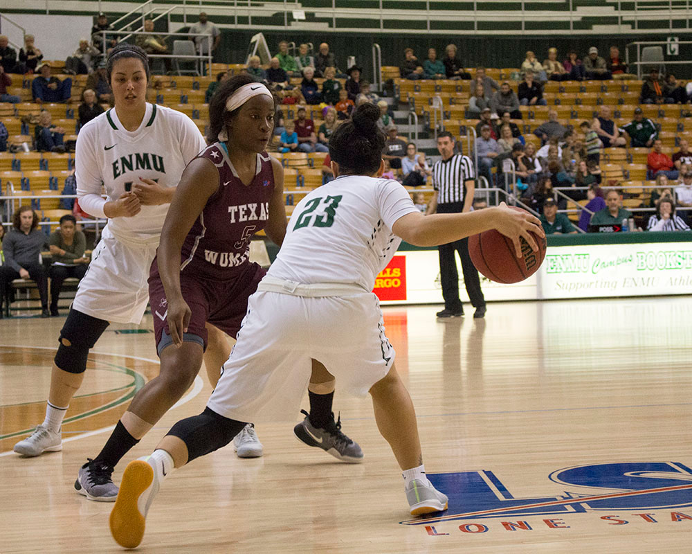 On Thursday, February 9, 2017, Eastern New Mexico University squared off with Texas Woman's University at the Greyhound Arena. ENMU junior and #44, Eliza Martinez, picks for junior and #23, Jasmine Hotchkins, as she rounds about Kara Mitchell (Texas Woman's sophomore). ENMU Greyhounds leave with a win 84-81, their 14th LSC conference win.
