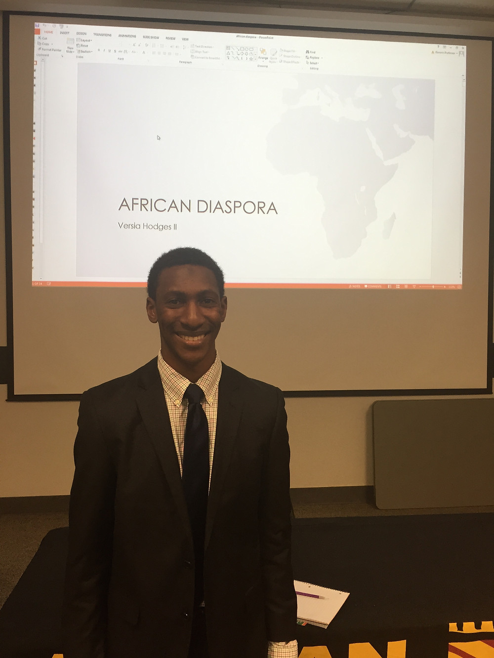Versia Hodges II presenting on African Diaspora, Photo taken by Emiliana Walker