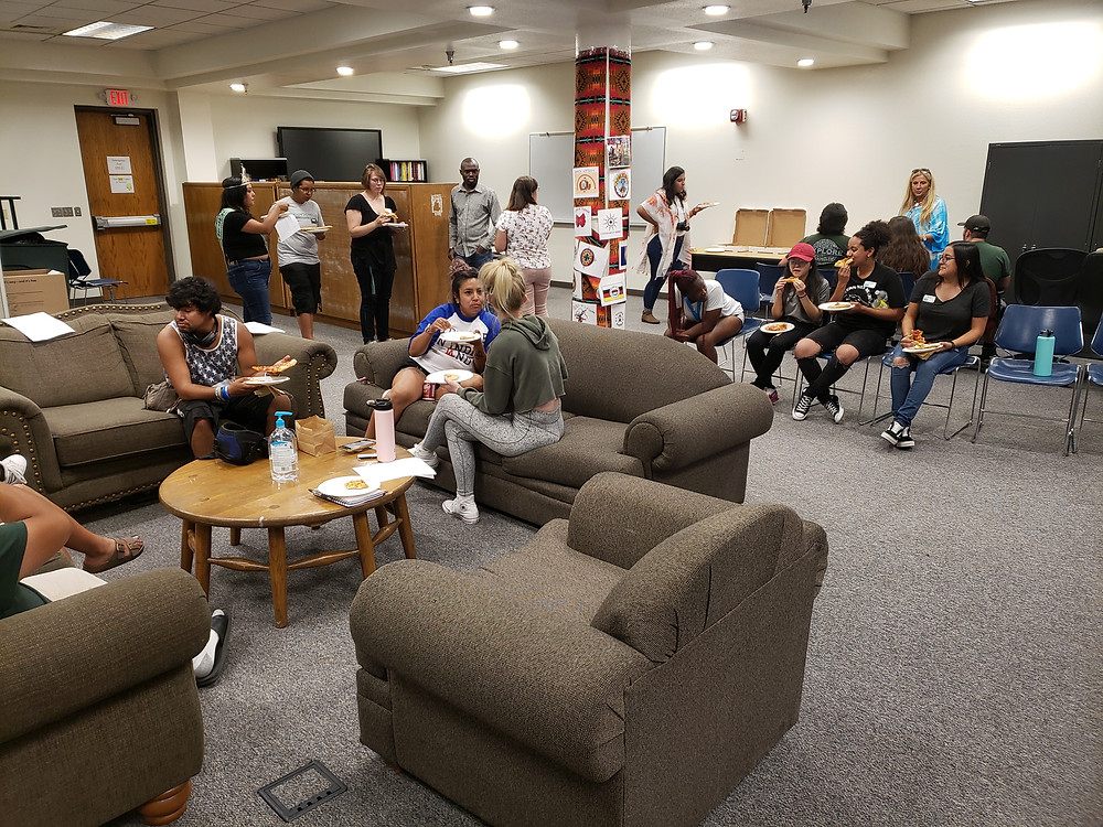 Attendees socialize and eat during the Native American Affairs' pizza social on Aug. 28.