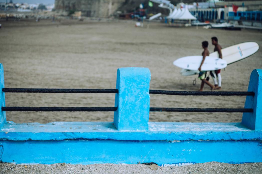Surfers on the beach of Rabat.