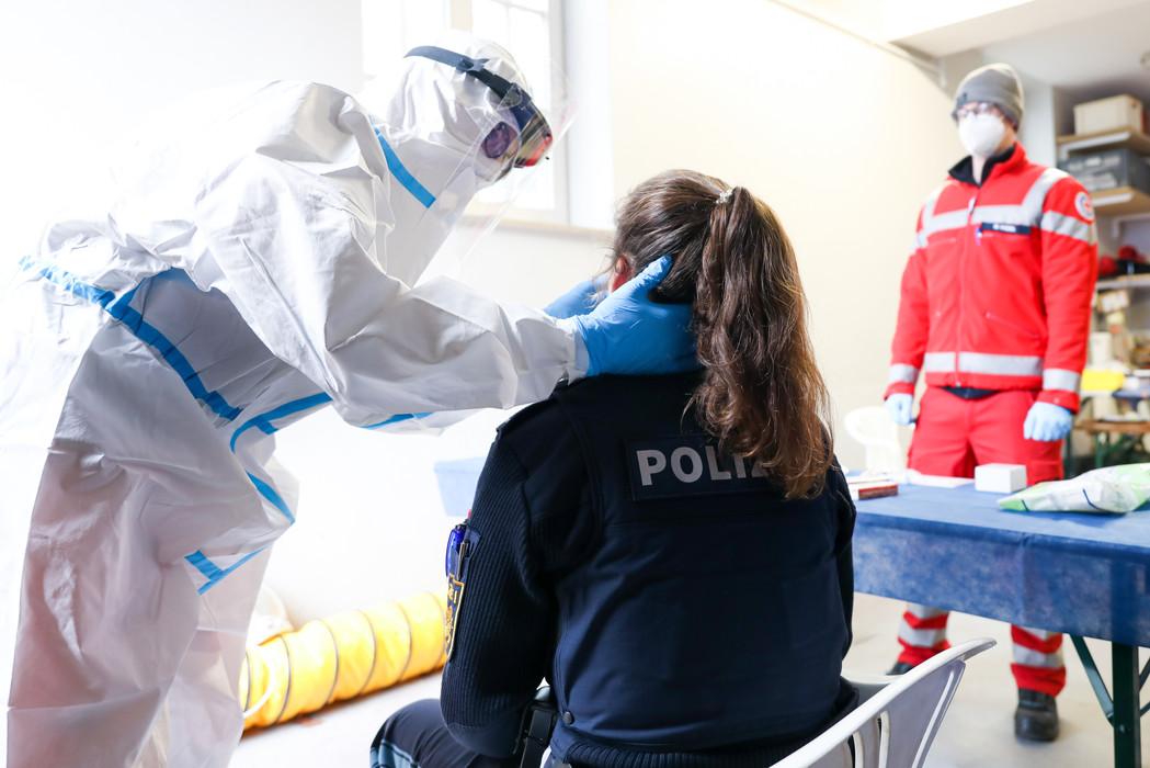 A policewoman undergoes a Corona quick test