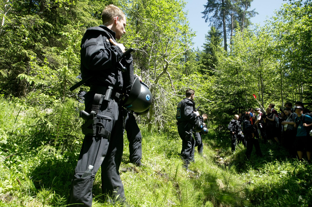 Police officers in the forest near the Elmau hotel during protests against the G7 summit.