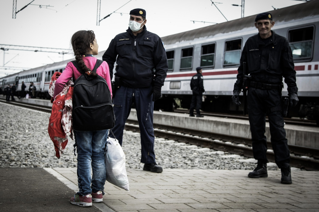 Refugees and police at the train station of Tovarnik, Croatia.