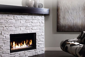 a zero clearance fireplace with a brick surround
