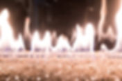 a close up image of a DaVinci fireplace with a lit fire