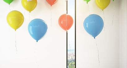 a room with balloons floating in it