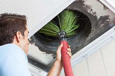 a man putting a Rotobrush into a heating duct