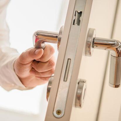 a hand opening a door