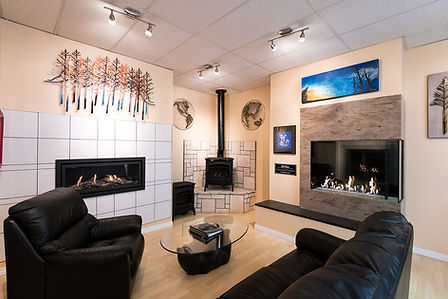 the Fraser Plumbing and Heating showroom featuring three fireplaces