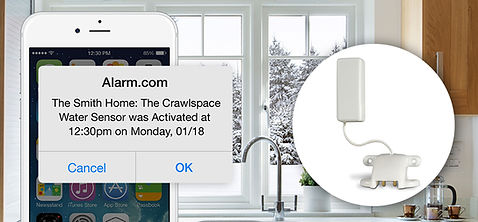 a cell phone notification from alarm.com with an image of a kitchen in the background