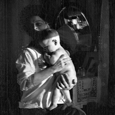 mom holding baby indoors.jpg