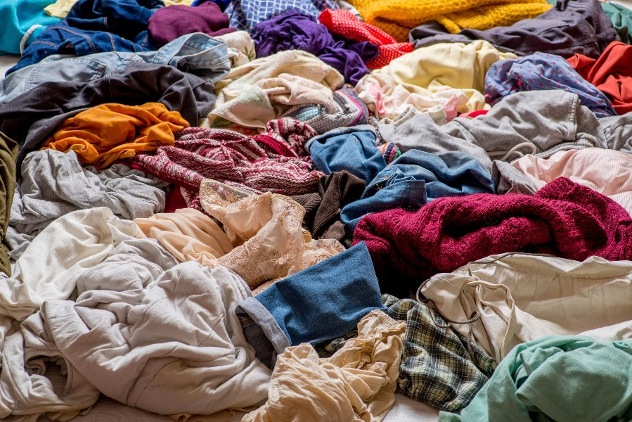 pile%20of%20used%20clothes%20on%20a%20li