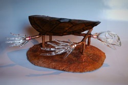 Glass turtle skeleton on copper tubing with solar panels