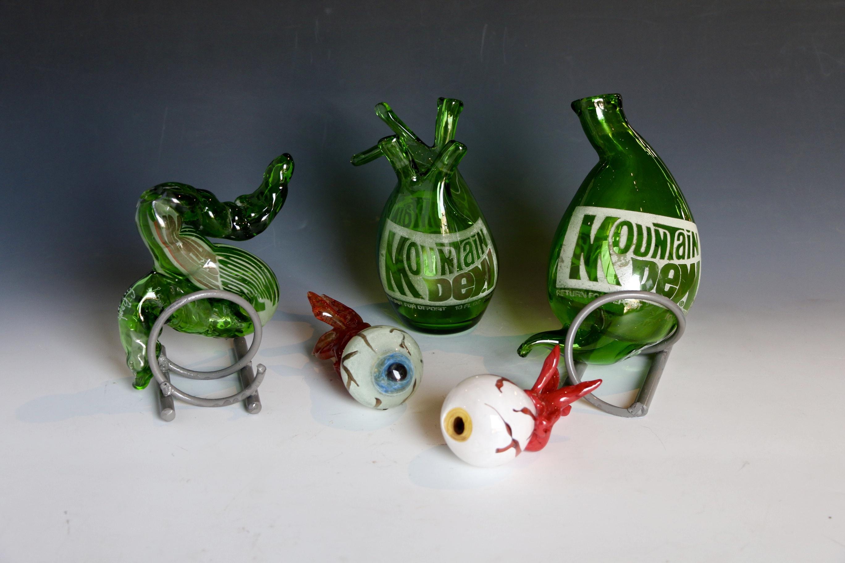Antique soda bottles sculpted into organs