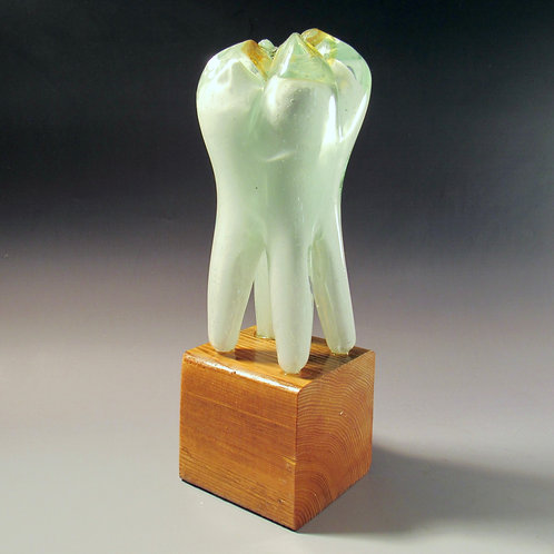 White Glass Tooth on Stand With Silver Filling