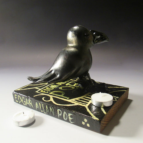 Glass Raven on a Wooden Book