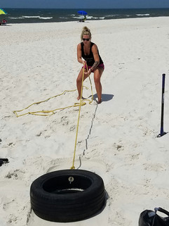 Draggin a tire in the sand is much harder than it looks.