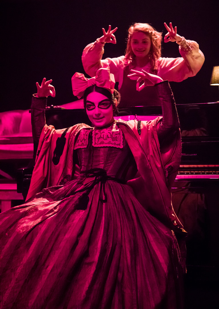 Eliza Shea as Alice and Tamara Sevunts as the Cheshire Cat