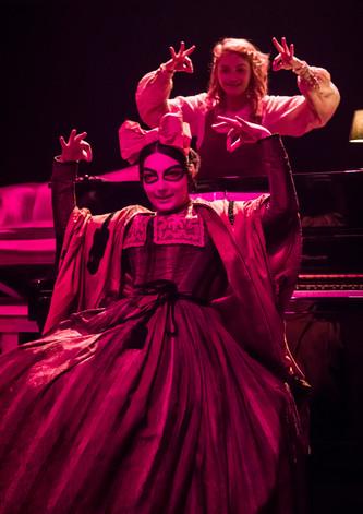 Eliza Shea as Alice and Tamara Sevunts as the Cheshire Cat