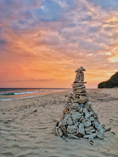 Building towers with corals one step at a time on Bali beaches.