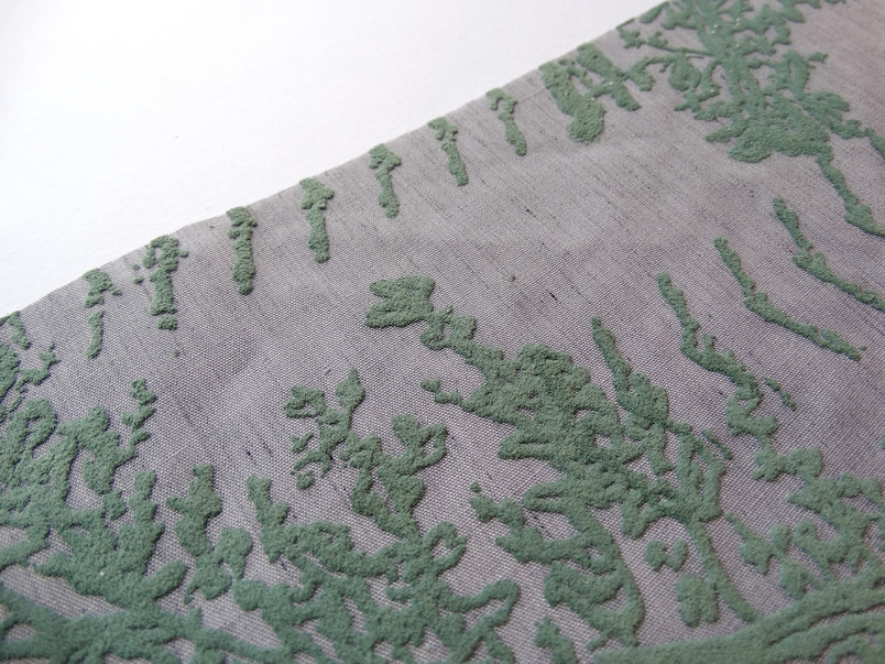 hand-dyed fabric witha rasied and textured fern and geometric design