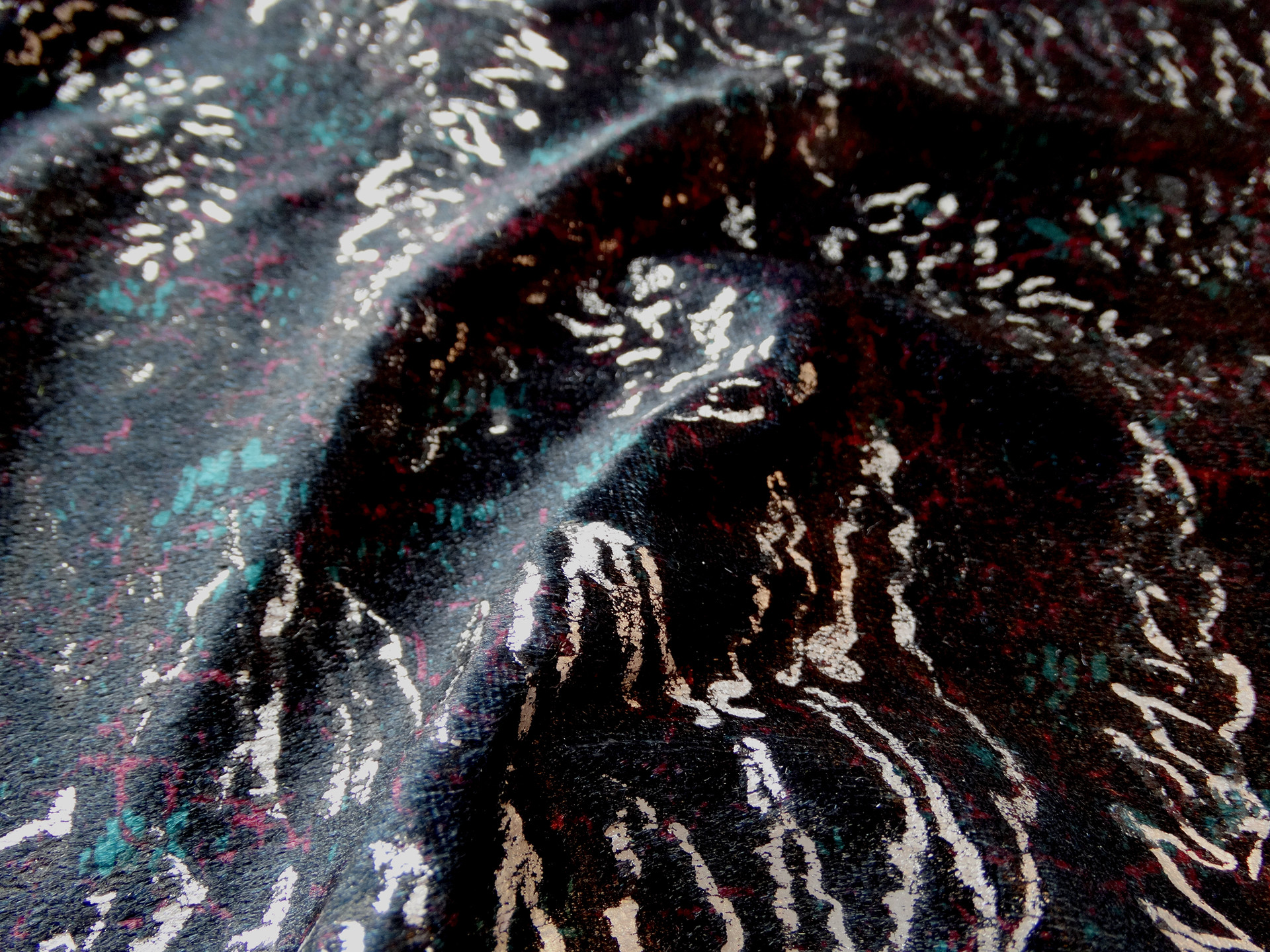 a moody and sumptuous fabric, featuring silver-foiled fractured ferns