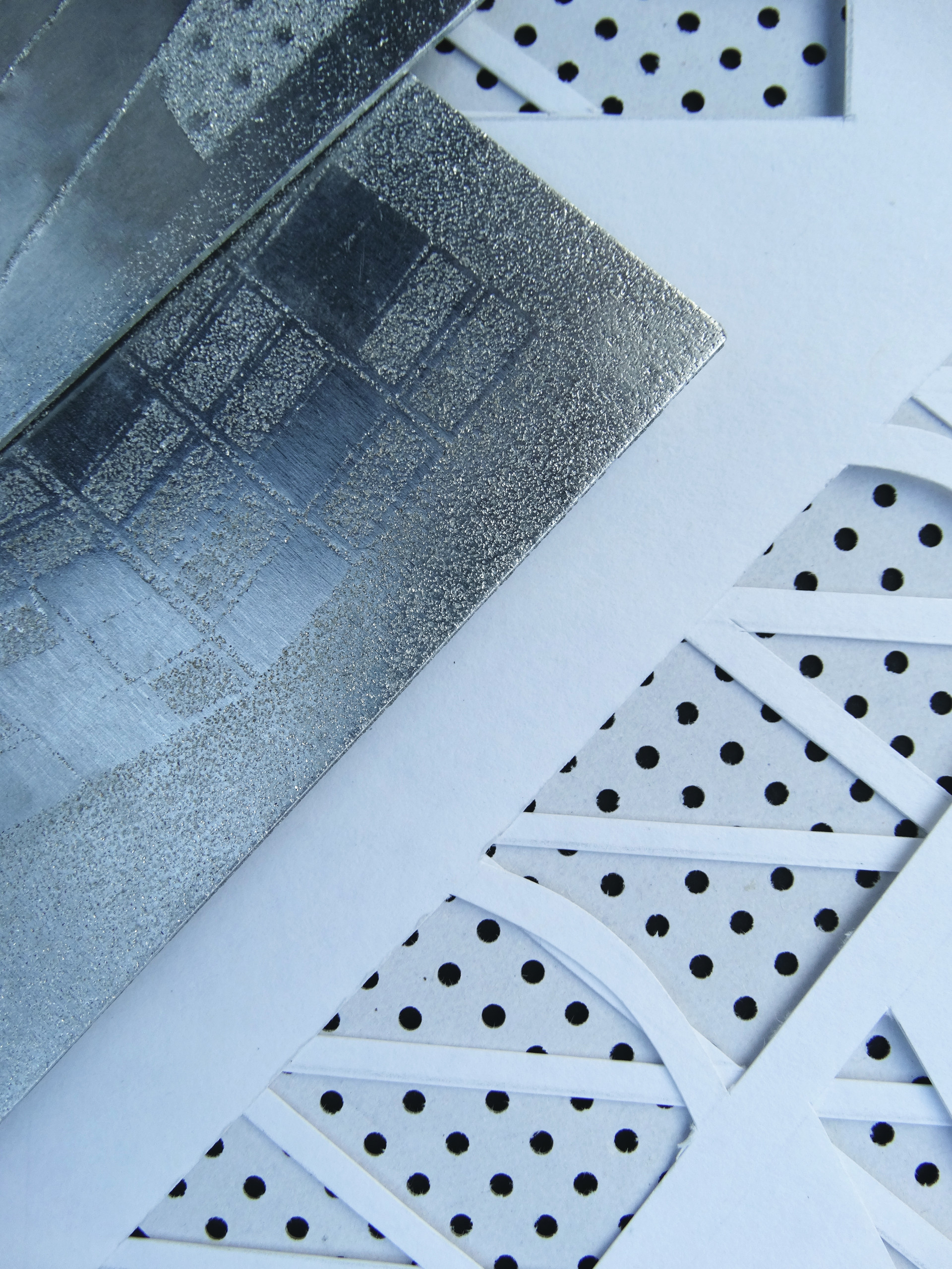 textured-effect metal surface with geometric pattern inspired by details of London's iconic Barbican