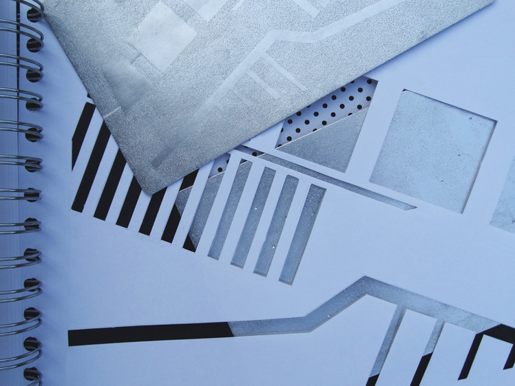 minimalist and graphic imagery, from paper-based design to metal surface
