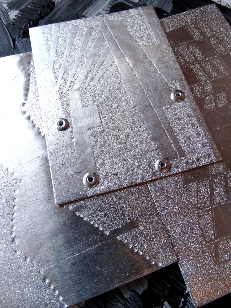 individual metal surfaces riveted together to form a solid piece