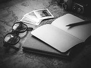 black-frame-eyeglasses-beside-open-book-