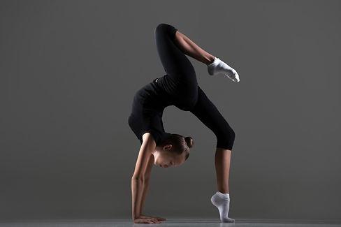 girl-doing-handstand-with-leg-floor_1163