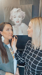 hannah applying lipstick.JPG