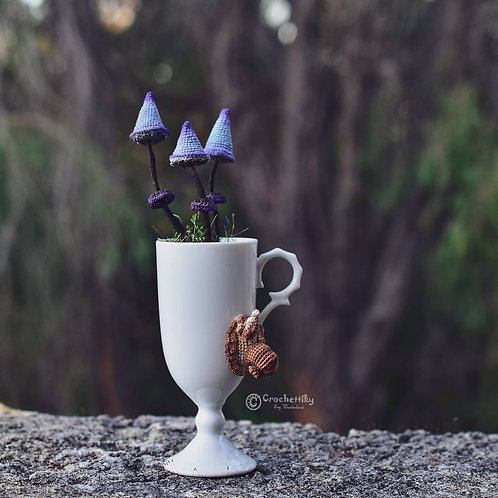 Blue-purple mushrooms in a vintage mug and a snail