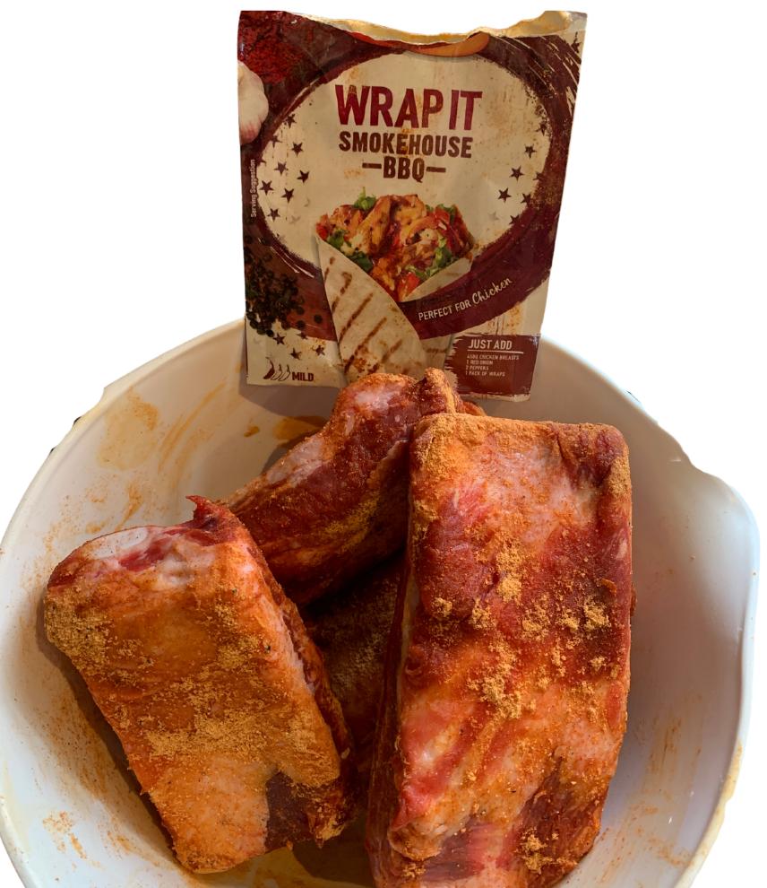 Ribs marinating in a bbq flavour seasoning