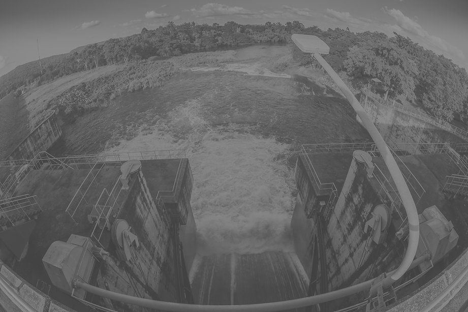 water-flowing-from-the-open-sluice-gates-of-dam_edited.jpg