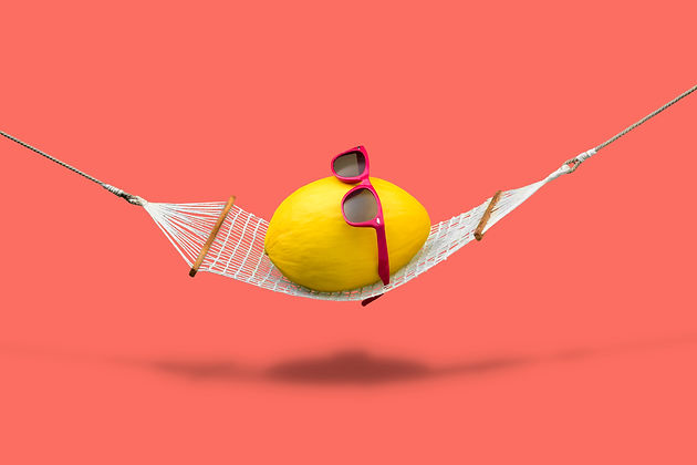 Yellow canary melon with red sunglasses