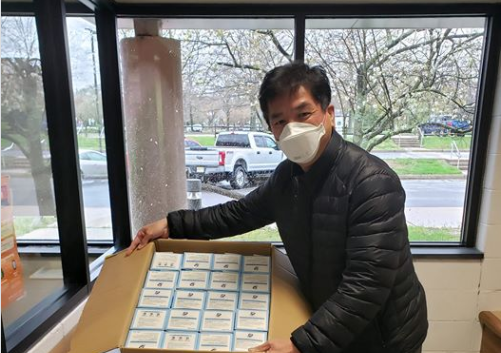 Jordan Hu, CEO of RiskVal donating N95 masks to local police station