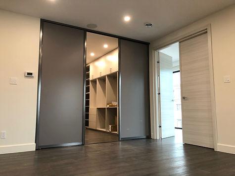 dark-grey-sliding-doors-for-walk-in-clos