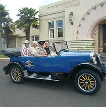 Getting dressed up is all part of the fun of riding in a classic car