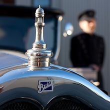 Walk out to a beautiful vintage car and your very own chauffeur