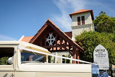 Vintage wedding car outside Eskdale Chuch,Hawke's bay