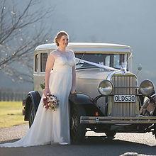 Beautiful Wedding car and bride