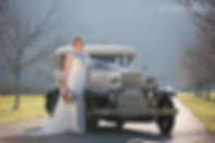 Beautiful bride with her vintage wedding car