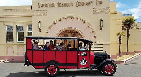 Retro tour bus around seaside town