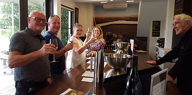 Group enjoying tasting a selection of wines at Crossroads Winery