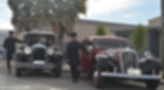 Period Chauffeurs await by their vinatge and classic cars